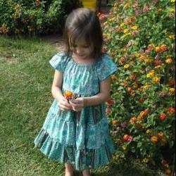 Girls Ruffled Dress size 4, short sleeves, tie sash, full twirl skirt
